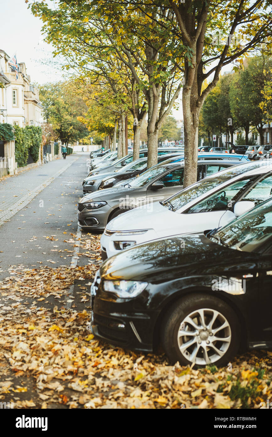 STRASBOURG, FRANCE - NOV 1, 2017: Cars parked on a row on French street - Stock Photo