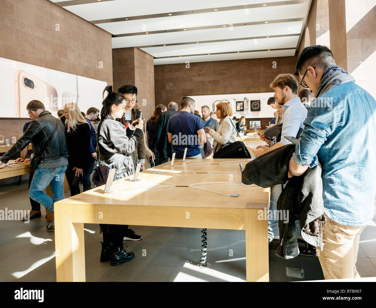 PARIS, FRANCE - SEP 22, 2017: New iPhone 8 and iPhone 8 Plus, as well the updated Apple Watch, Apple TV goes on sale today in Apple Store with customers trying the new iPhone and Apple Watch  Stock Photo