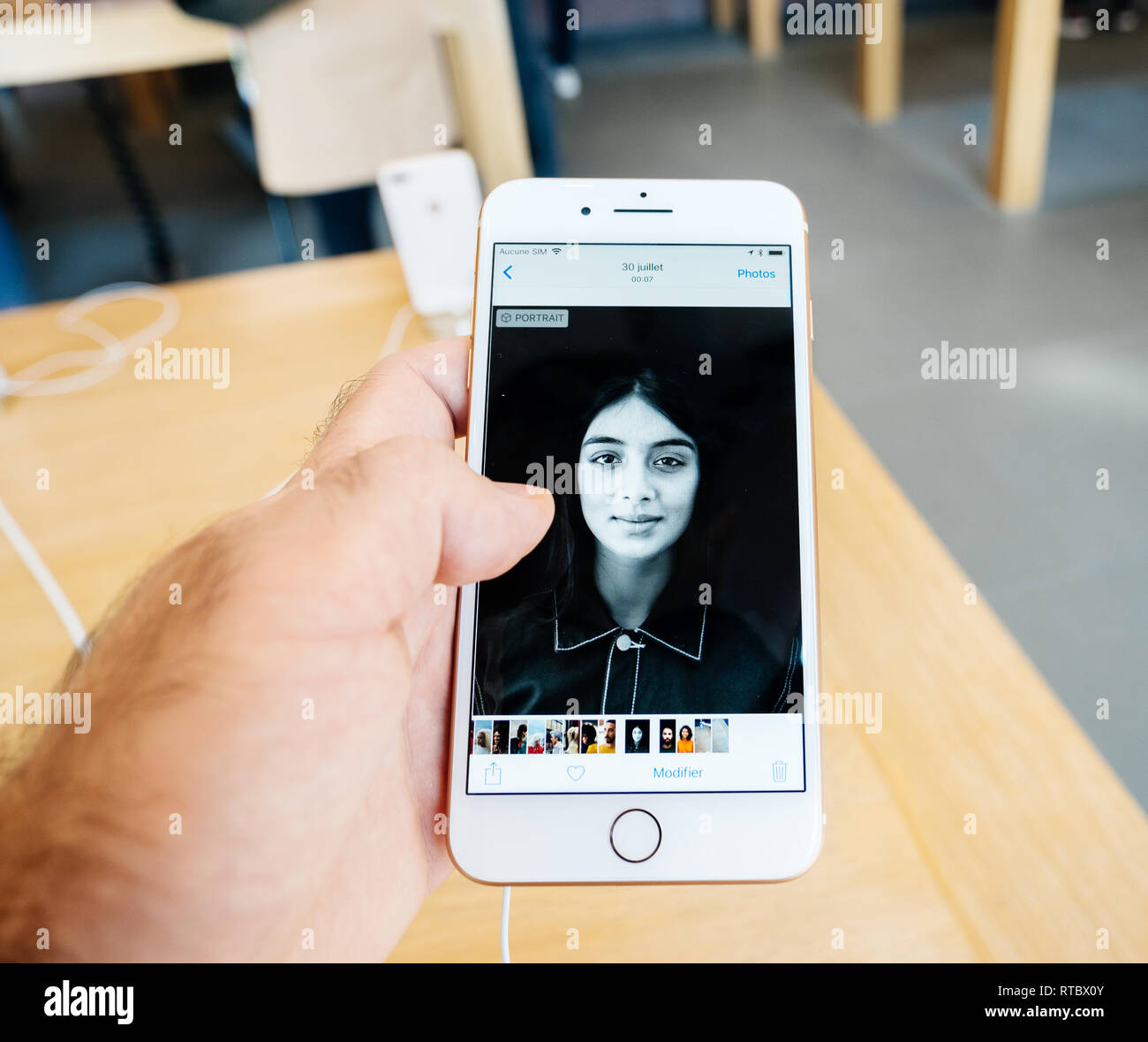 PARIS, FRANCE - SEP 22, 2017: New iPhone 8 and iPhone 8 Plus, as well the updated Apple Watch, Apple TV goes on sale today in Apple Store - point of view at new photos taken with 12 mpx camera  - Stock Image