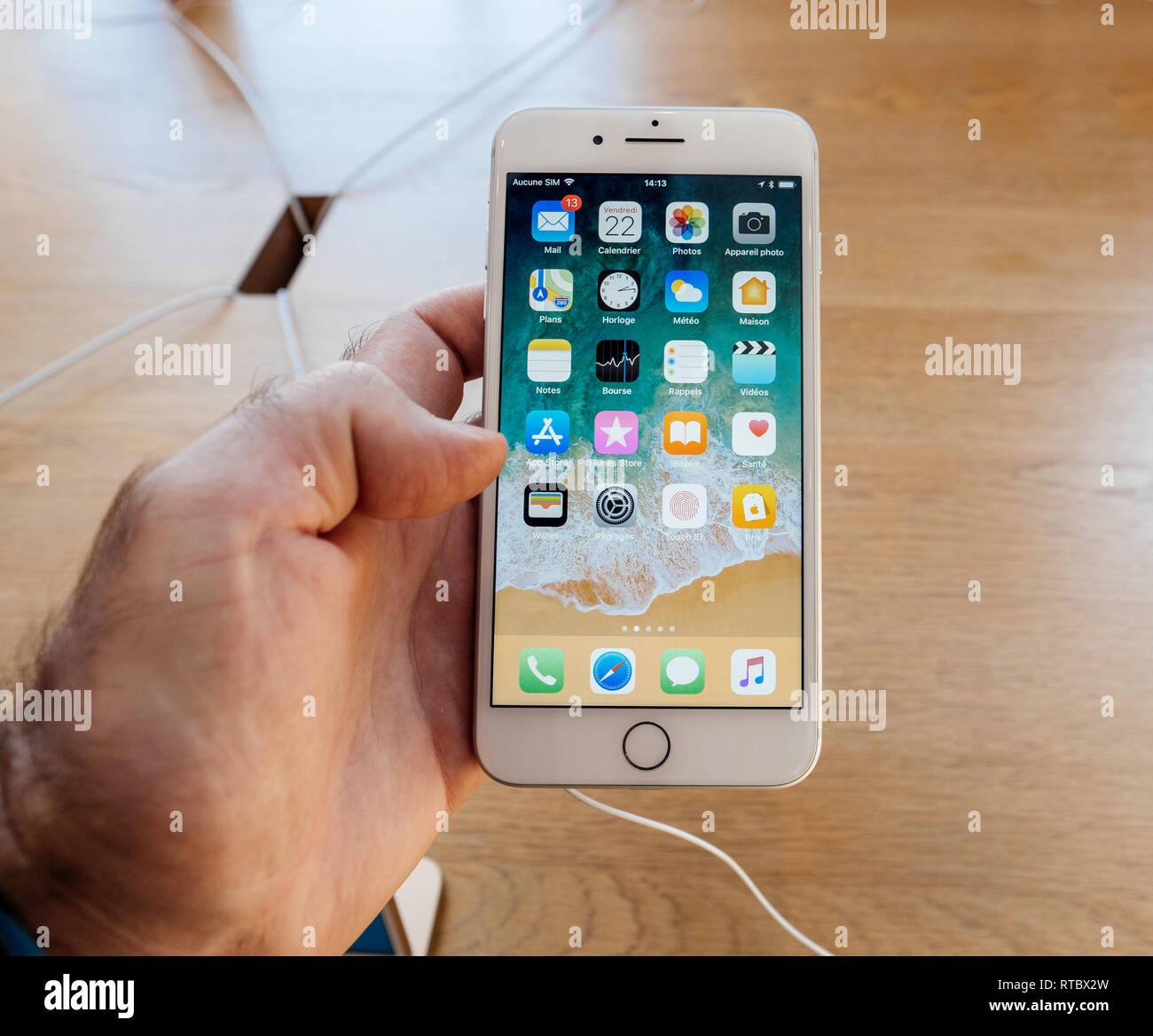 PARIS, FRANCE - SEP 22, 2017: New iPhone 8 and iPhone 8 Plus, as well the updated Apple Watch, Apple TV goes on sale today in Apple Store with customer lookming on the Apps by Apple  Stock Photo