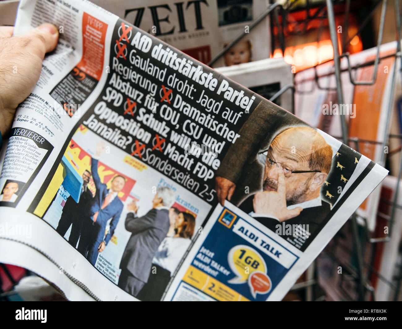 PARIS, FRANCE - SEP 25, 2017: International newspaper with portrait of Martin Schulz after election in Germany for the Chancellor of Germany, the head of the federal government Stock Photo