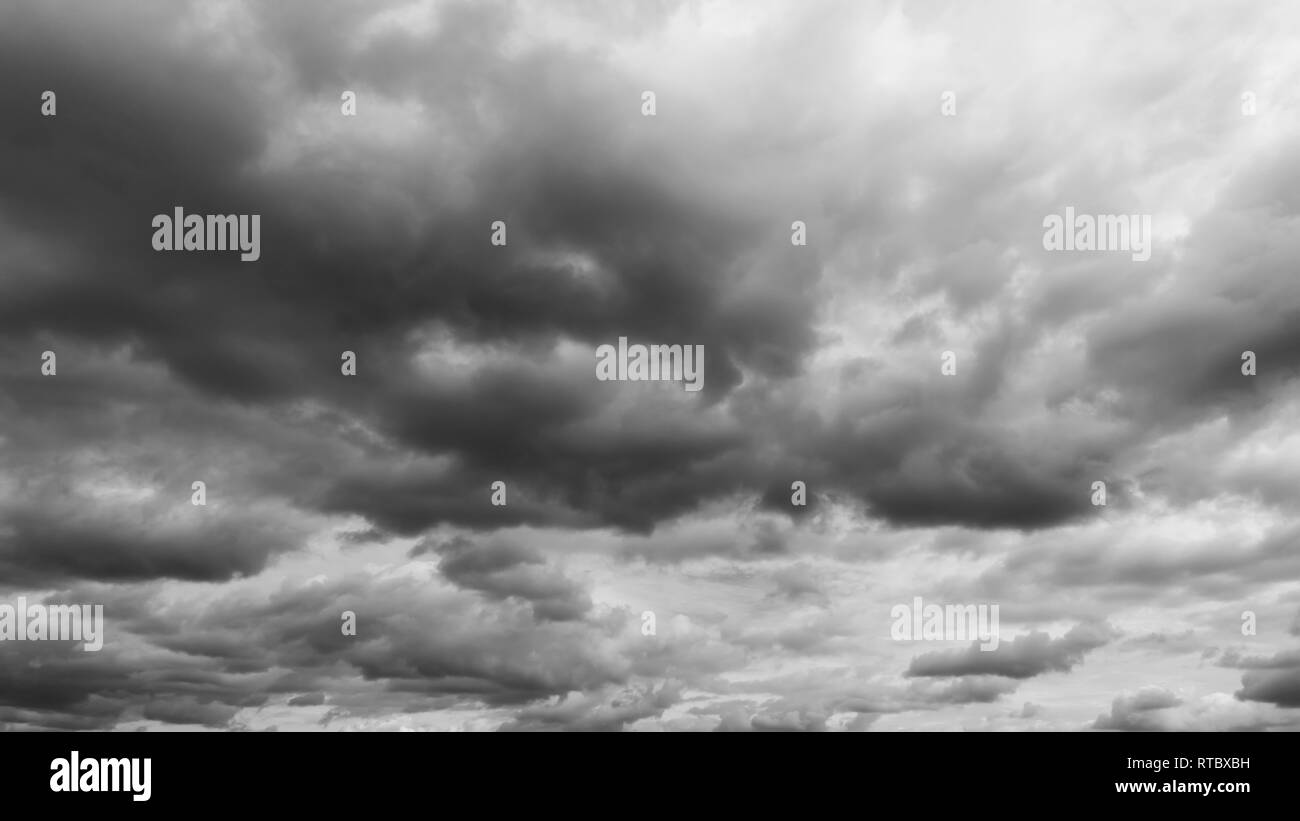 Panorama of beautiful thunder clouds. Overcast sky panorama. - Stock Image