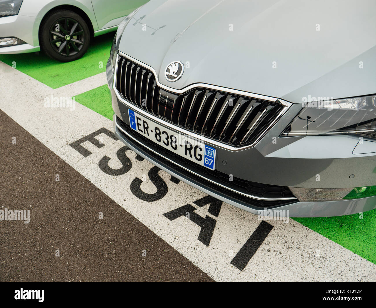 PARIS, FRANCE - NOV 7, 2017: Essai text translated as Test Drive cars with Skoda Superb luxury car made by Volkswagen at the car dealership garage Stock Photo