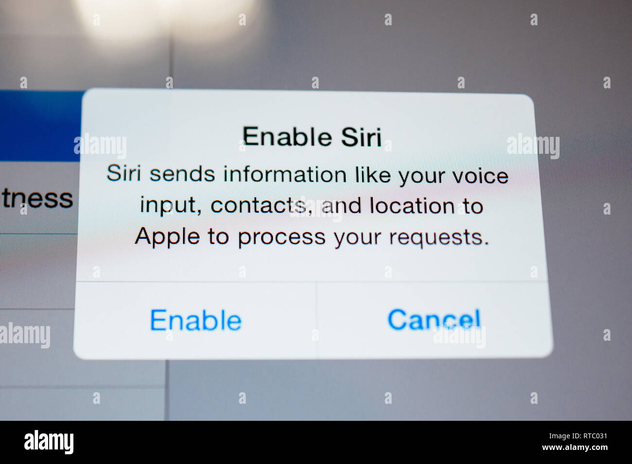 PARIS, FRANCE - SEP 18, 2014: Enable Siri personal voice