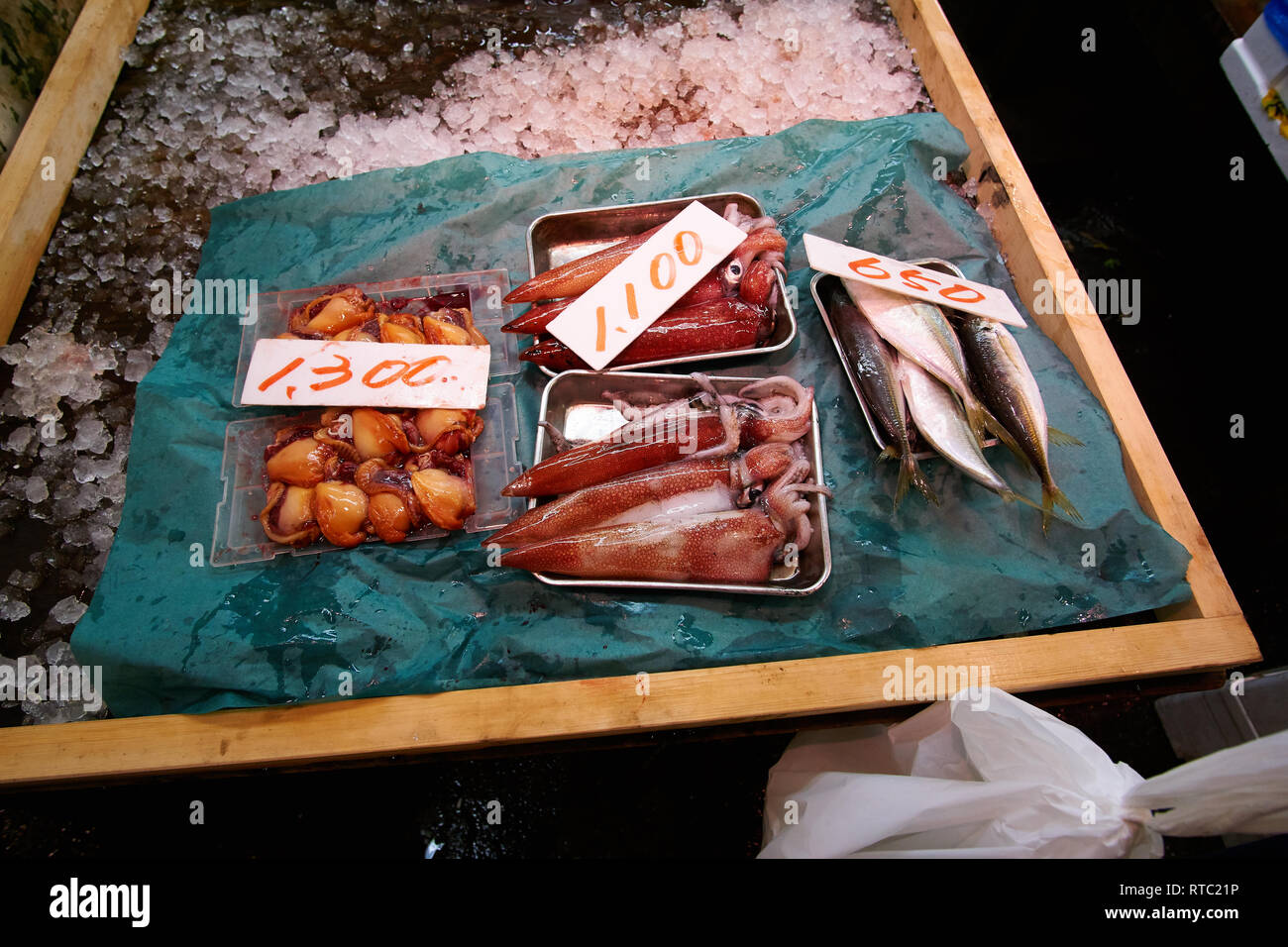 Fresh squid and other seafood is sold in the (now closed