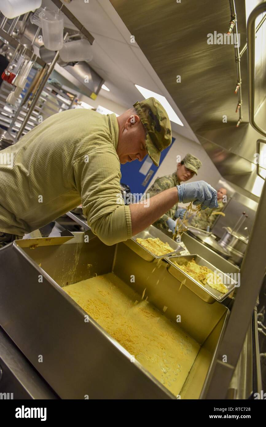 U.S. Air National Guard Tech. Sgt. Scott Lauderbaugh assigned to the Force Support Squadron, 171st Air Refueling Wing prepares lunch for the 171st drill status guardsmen during a unit training assembly, Feb. 10, 2019. The FSS prepares lunch for nearly 1,300 guardsmen each unit UTA. Stock Photo