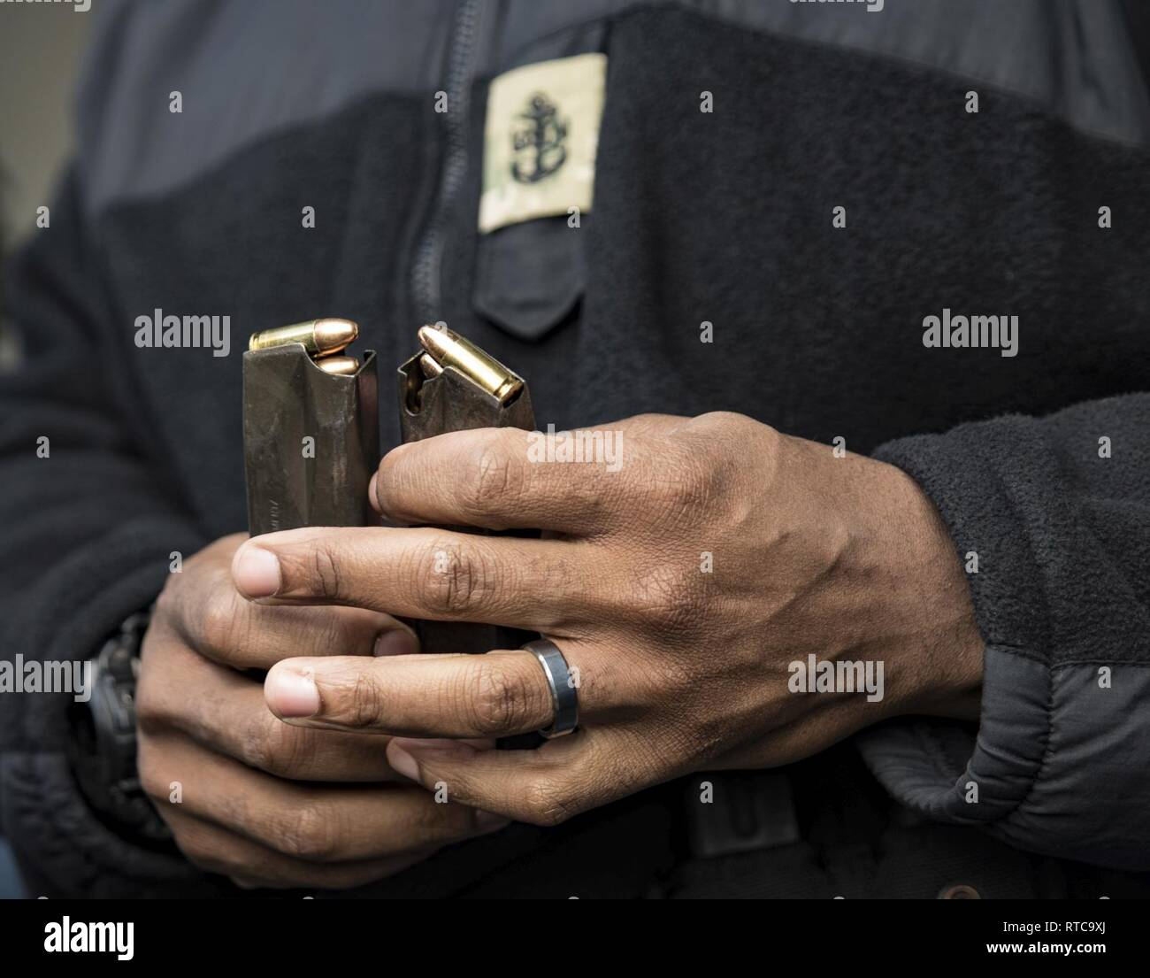 PHILIPPINE SEA (Feb. 12, 2019) - Chief Intelligence Specialist Robert Campbell, from Waldorf, Maryland, prepares ammunition for a live fire exercise aboard the amphibious assault ship USS Wasp (LHD 1). Wasp, flagship of Wasp Amphibious Ready Group, with embarked 31st Marine Expeditionary Unit, is operating in the Indo-Pacific region to enhance interoperability with partners and serve as a ready-response force for any type of contingency. - Stock Image