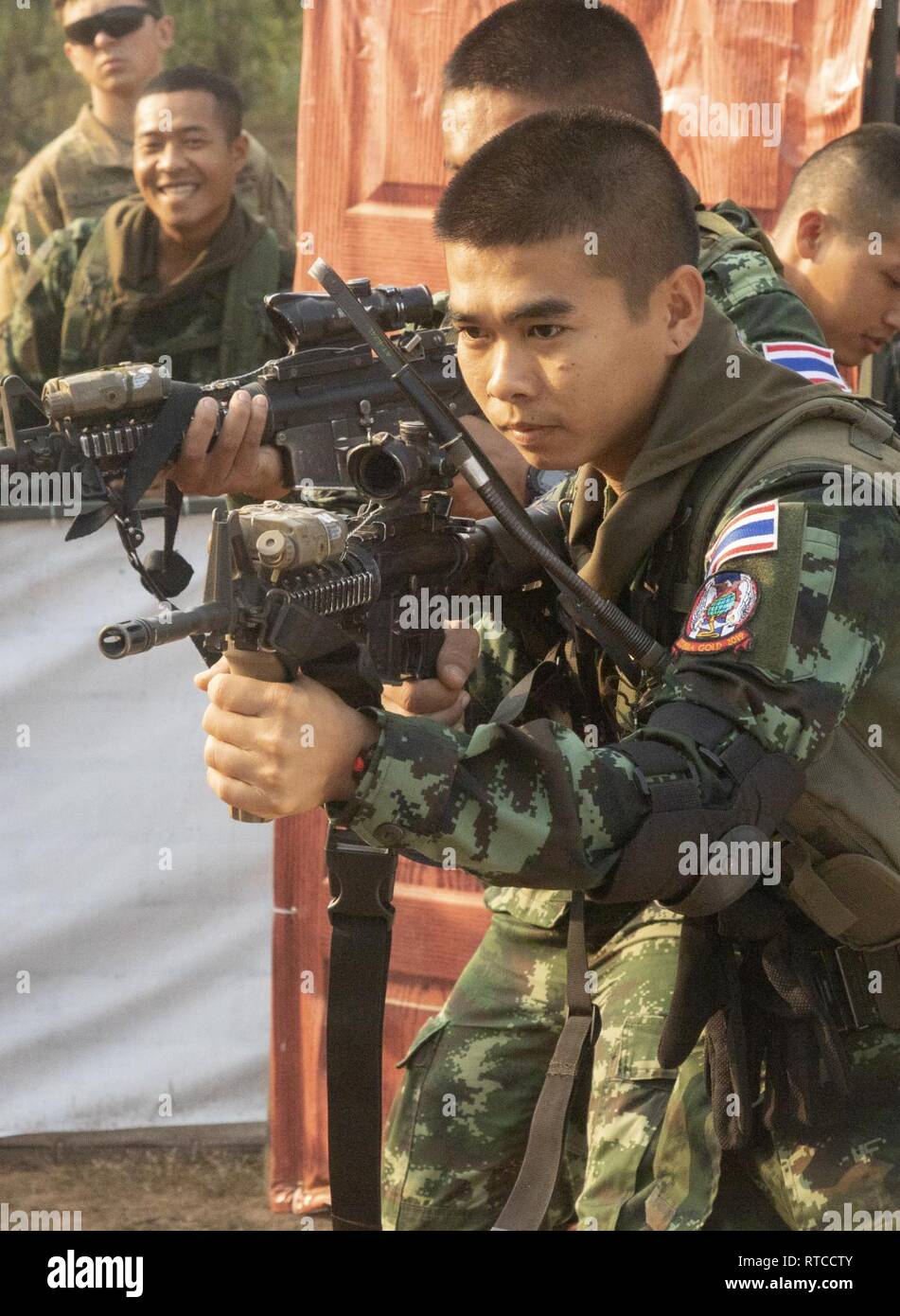 Royal Thai Army soldiers practice clearing a room using U S