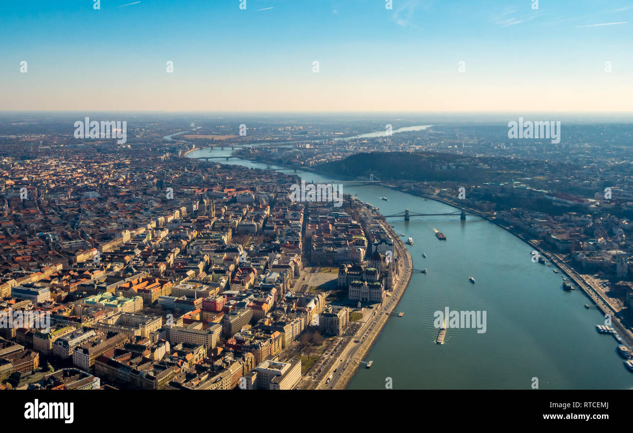 Image of areal view over the Hungarian capital city of Budapest with the river of danube and historical buildings and bridges during sunset Stock Photo