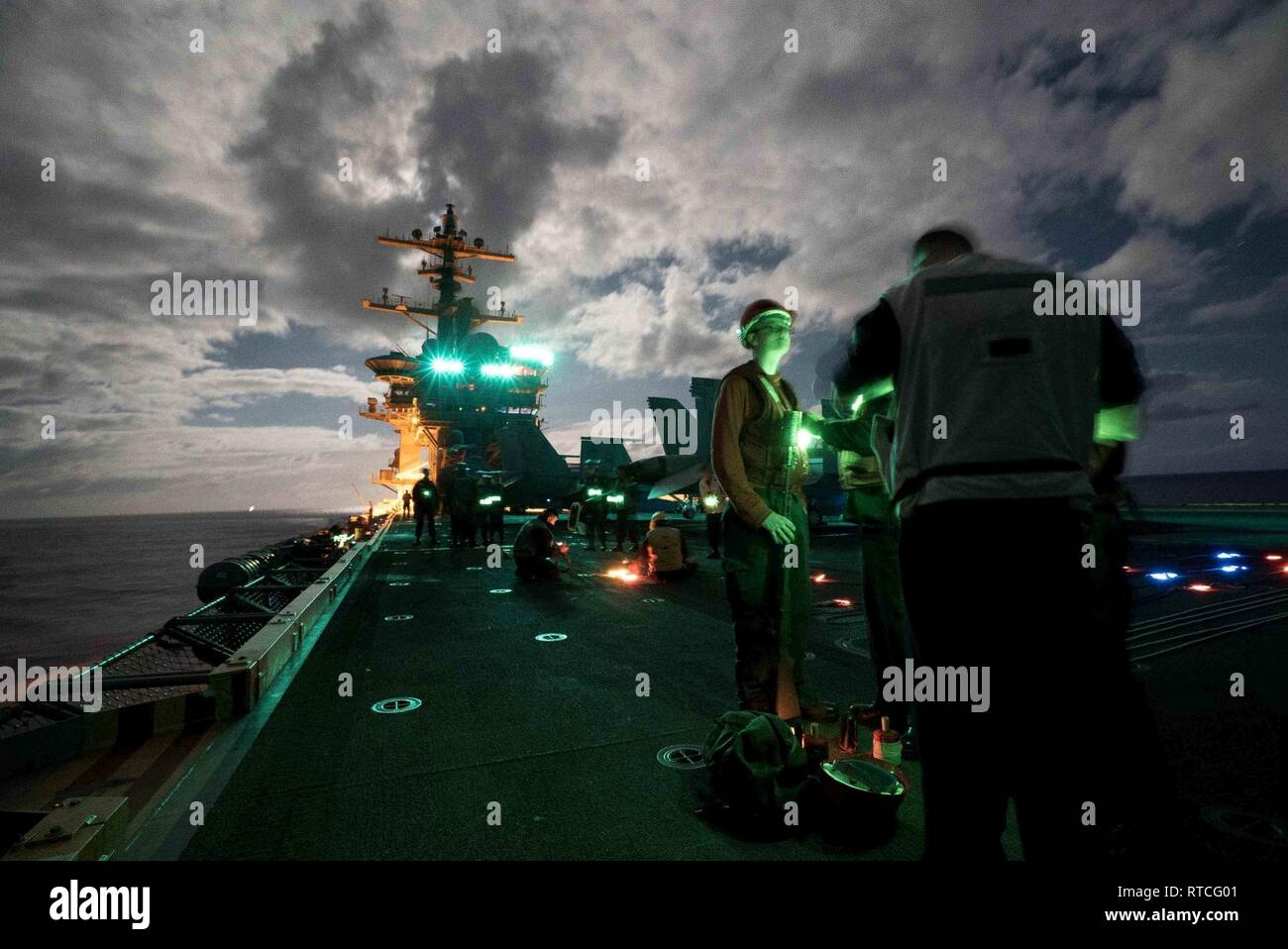 ATLANTIC OCEAN (Feb 16, 2019)  Sailors aboard the Nimitz-class aircraft carrier USS Abraham Lincoln (CVN 72) prepare for replenishment at sea with the Henry J. Kiser-class fleet replenishment oiler USNS Leroy Grumman (T-AO 195). Abraham Lincoln is underway conducting composite training unit exercise (COMPTUEX) with Carrier Strike Group (CSG) 12. The components of CSG 12 embody a 'team-of-teams' concept, combining advanced surface, air and systems assets to create and sustain operational capability. This enables them to prepare for and conduct global operations, have effective and lasting comma - Stock Image