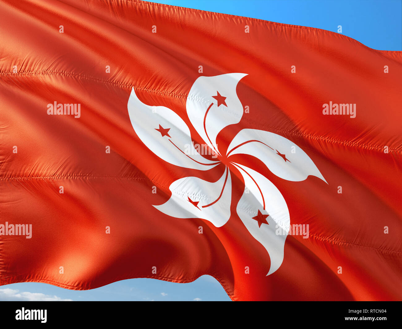Flag of Honk Kong waving in the wind against deep blue sky. High quality fabric. - Stock Image