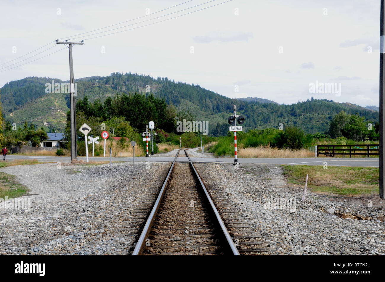 The tracks out of Reefton Station going in the direction of Greymouth and SH7. The line is the Stillwater-Westport line. - Stock Image