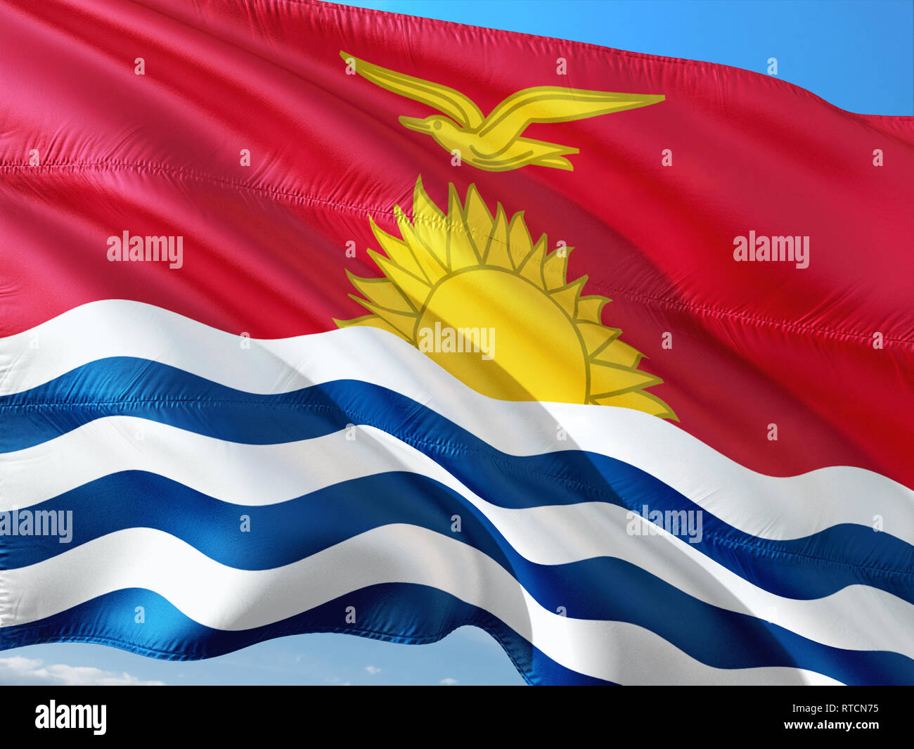 Flag of Kiribati waving in the wind against deep blue sky. High quality fabric. - Stock Image