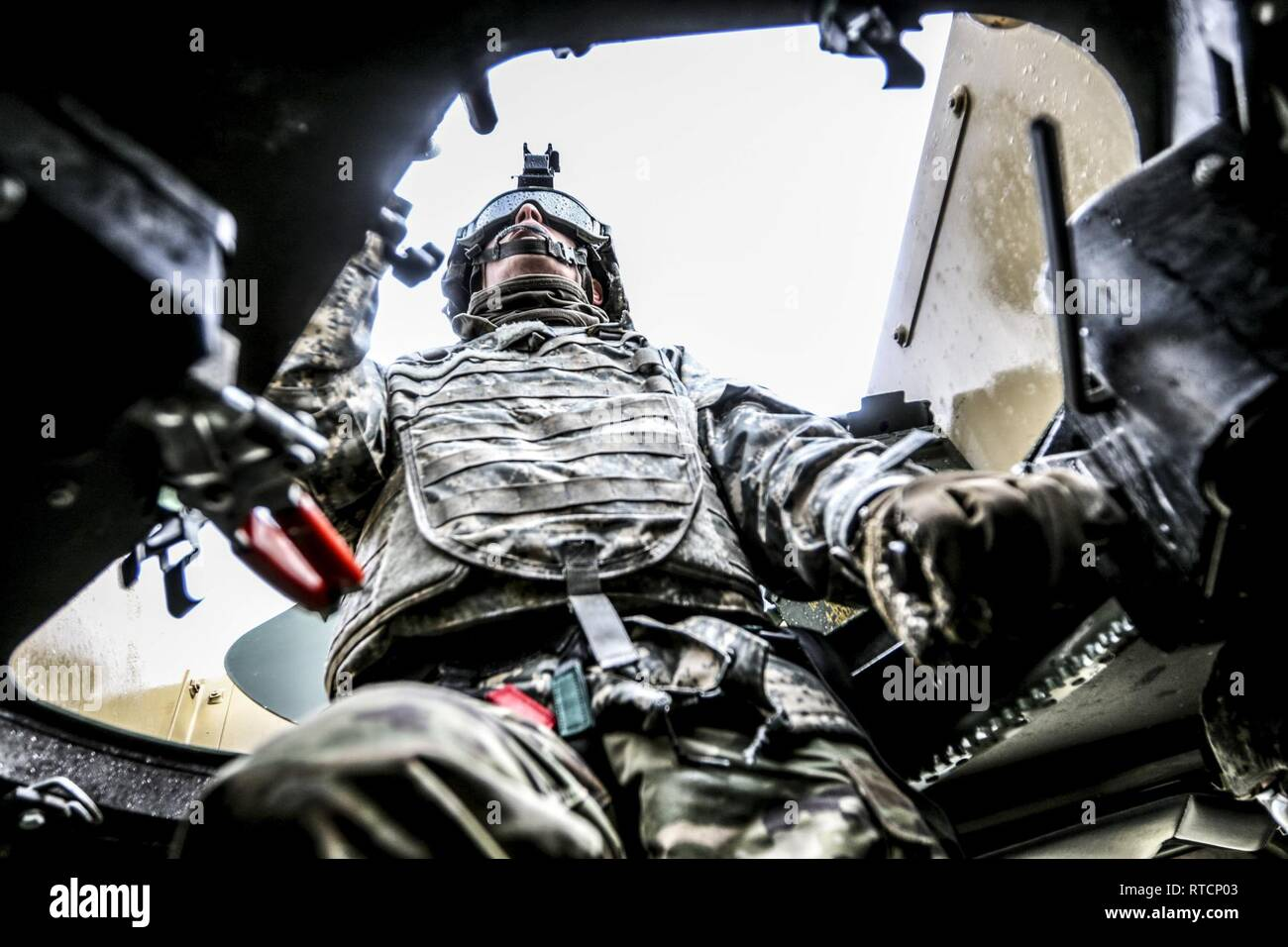 U.S. Army Reserve Spc. Forrest Bohlman, wheeled vehicle mechanic, 452nd Quartermaster Company, trains as a gunner during Operation Cold Steel III at Fort Hunter Liggett, Calif., Feb. 14, 2019. Operation Cold Steel III trains and qualifies Army Reserve Soldiers on M2 .50 caliber machine guns, M19 40 mm automatic grenade launchers and M240 7.62 mm machine guns weapons systems in ground and mounted military vehicles, in order to provide lethal and combat ready units ready to deploy anywhere in the world. - Stock Image