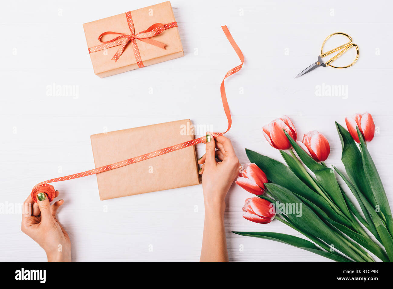 Flat Lay Festive Composition Of Female S Hands Making Handmade Gift