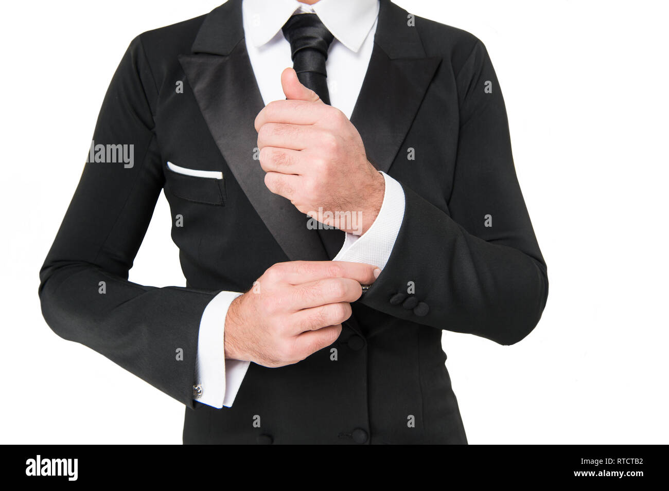 Hand fix white shirt sleeve cuff with cufflink. Business fashion style concept. - Stock Image