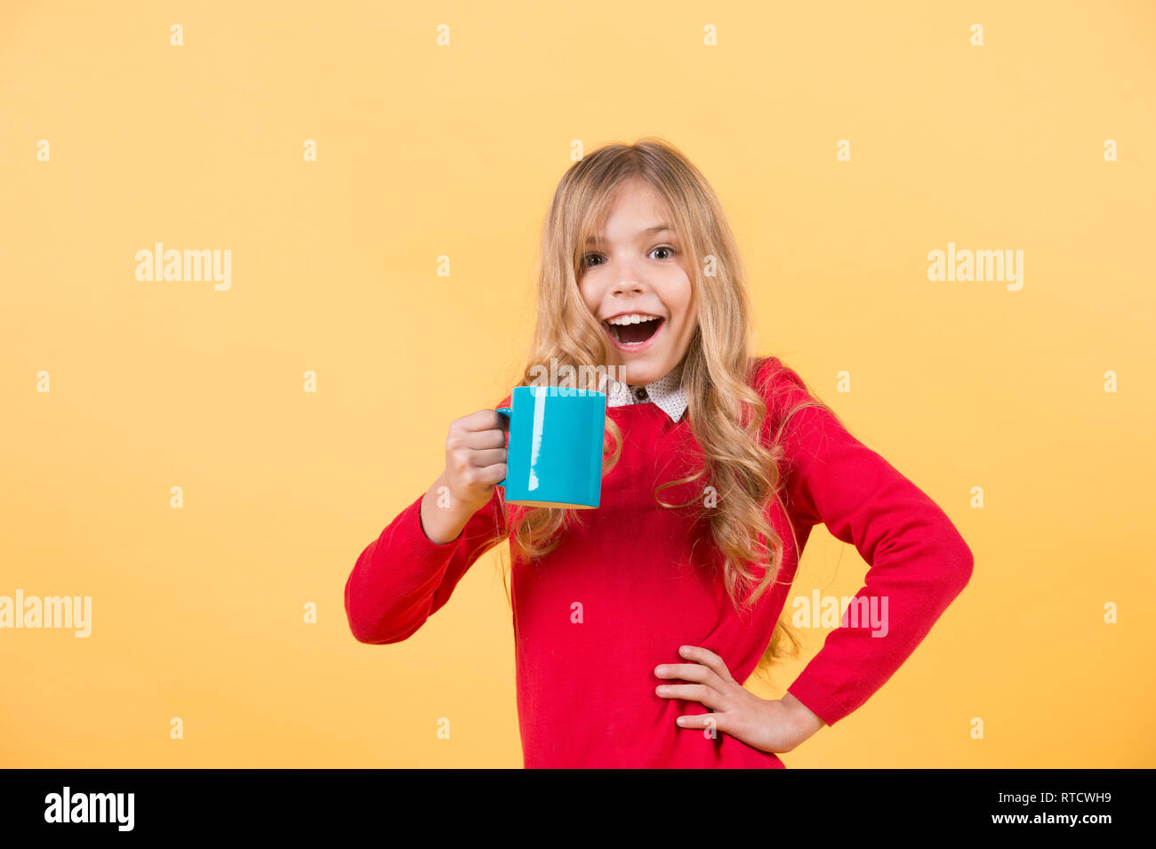 Tea or coffee break  Girl with long blond hair in red sweater with