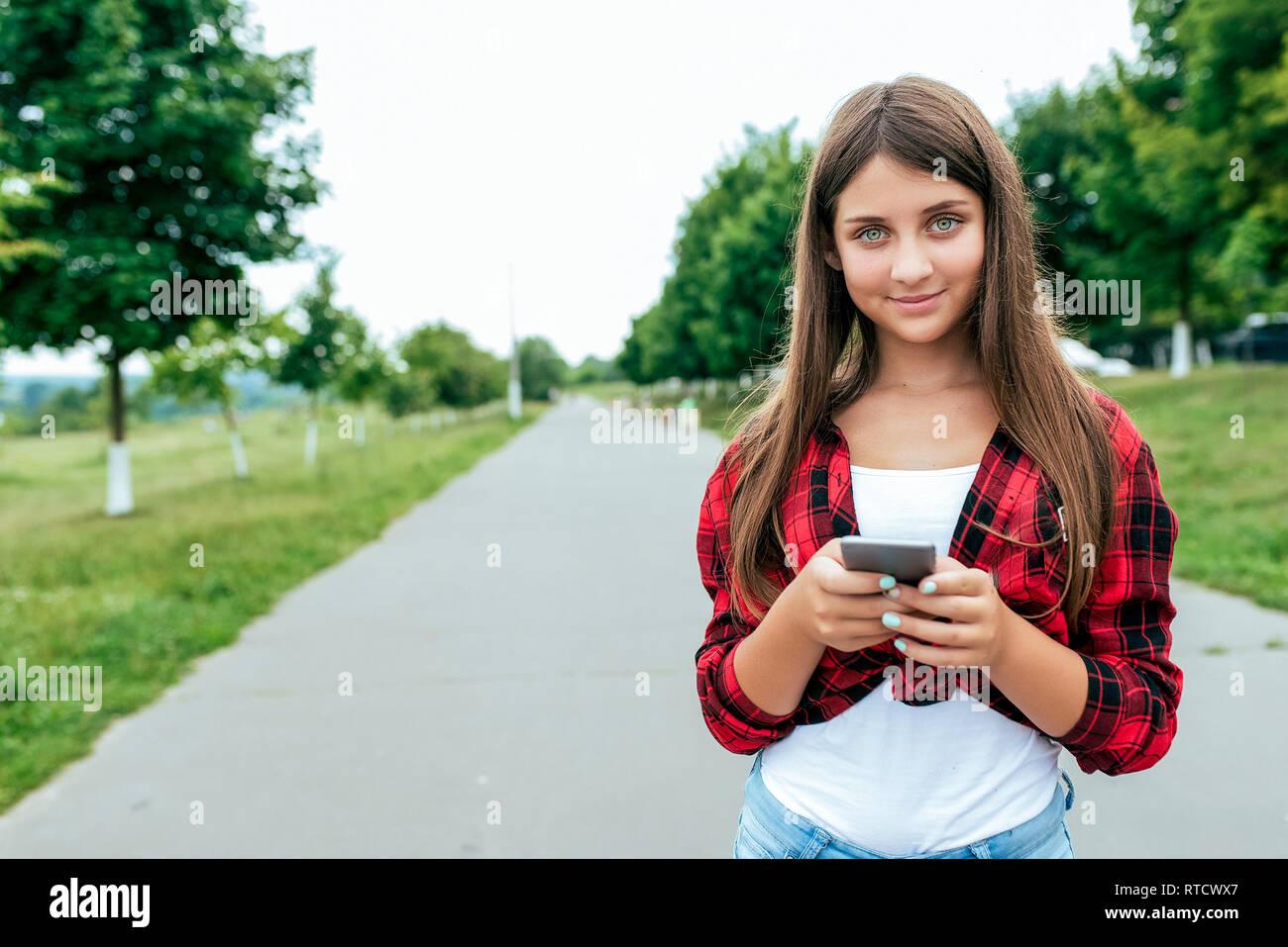 Girl schoolgirl teenager 10-15 years old, summer city after school