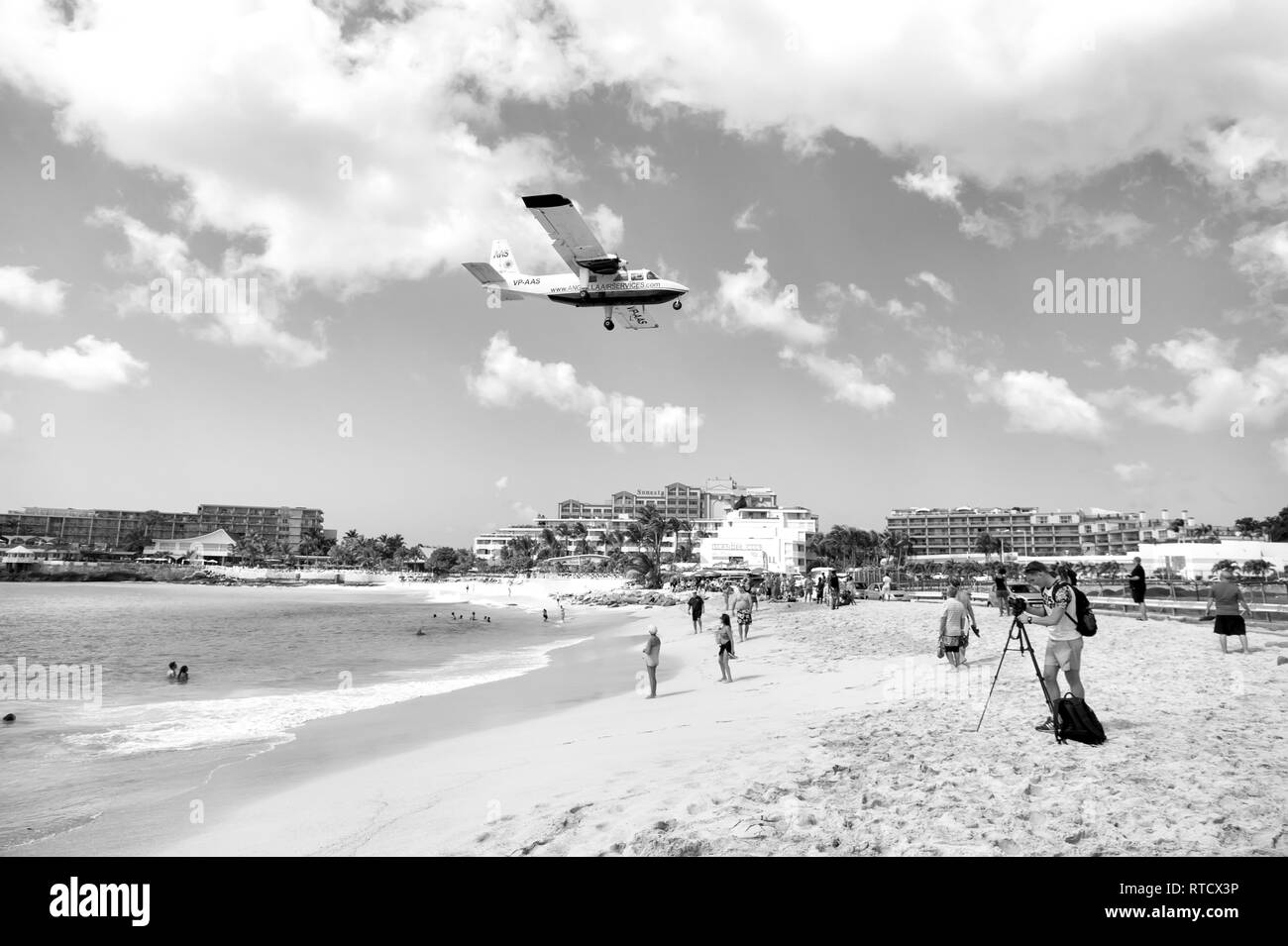 St Maarten, Netherlands - February 13, 2016: International jet flight lands over Maho beach at Princess Juliana airport on Caribbean island of St Martin - Stock Image