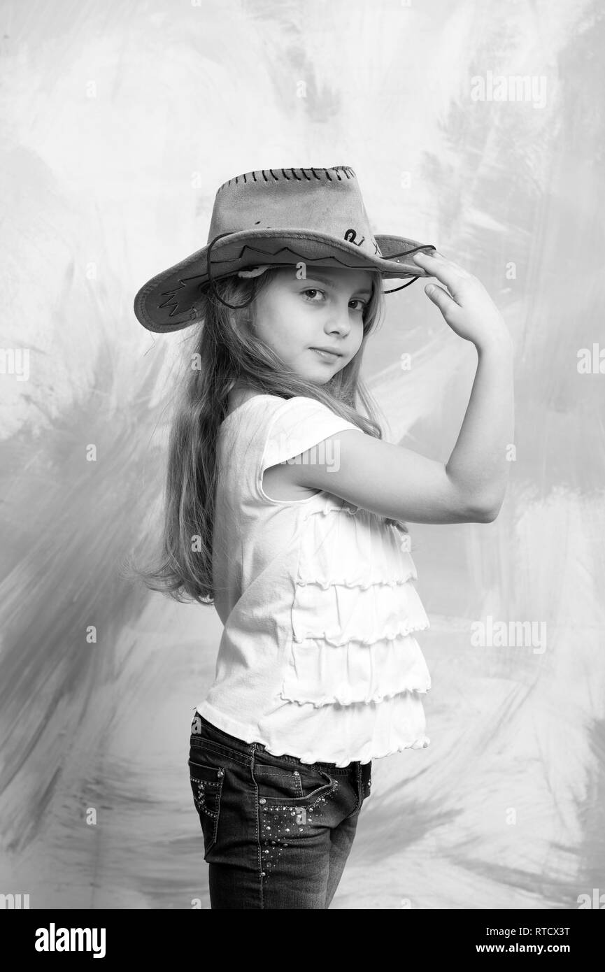 349e32cded7 kid or baby girl in summer t shirt and cowboy hat on colorful abstract  background