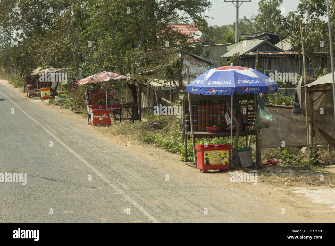 Refreshment stalls along the road in Cambodia - Stock Image