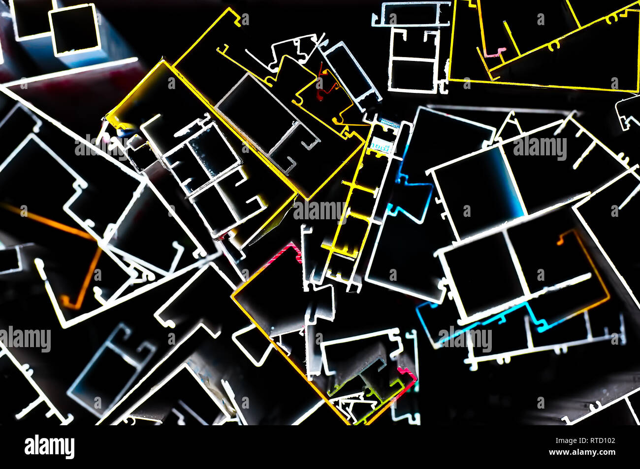 Graphic view of metal bars used in the construction business, marked in different colors for identification, photographed against a black background - Stock Image