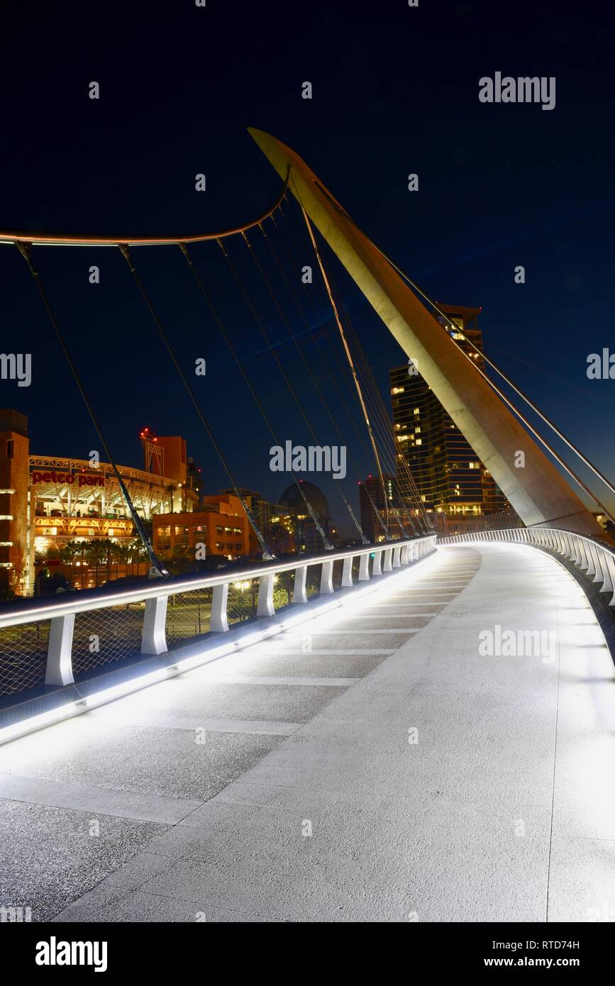 The iconic, modern 500-feet long Harbor Drive Pedestrian Bridge at sunrise, connects Petco Park to San Diego Bay and Convention Center, San Diego, USA Stock Photo