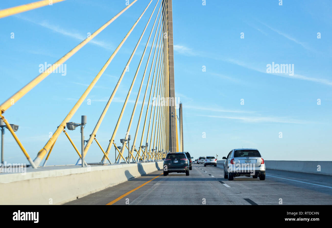 A toll road leads to the Sunshine Skyway Bridge south of St. Petersburg, Florida, USA. - Stock Image