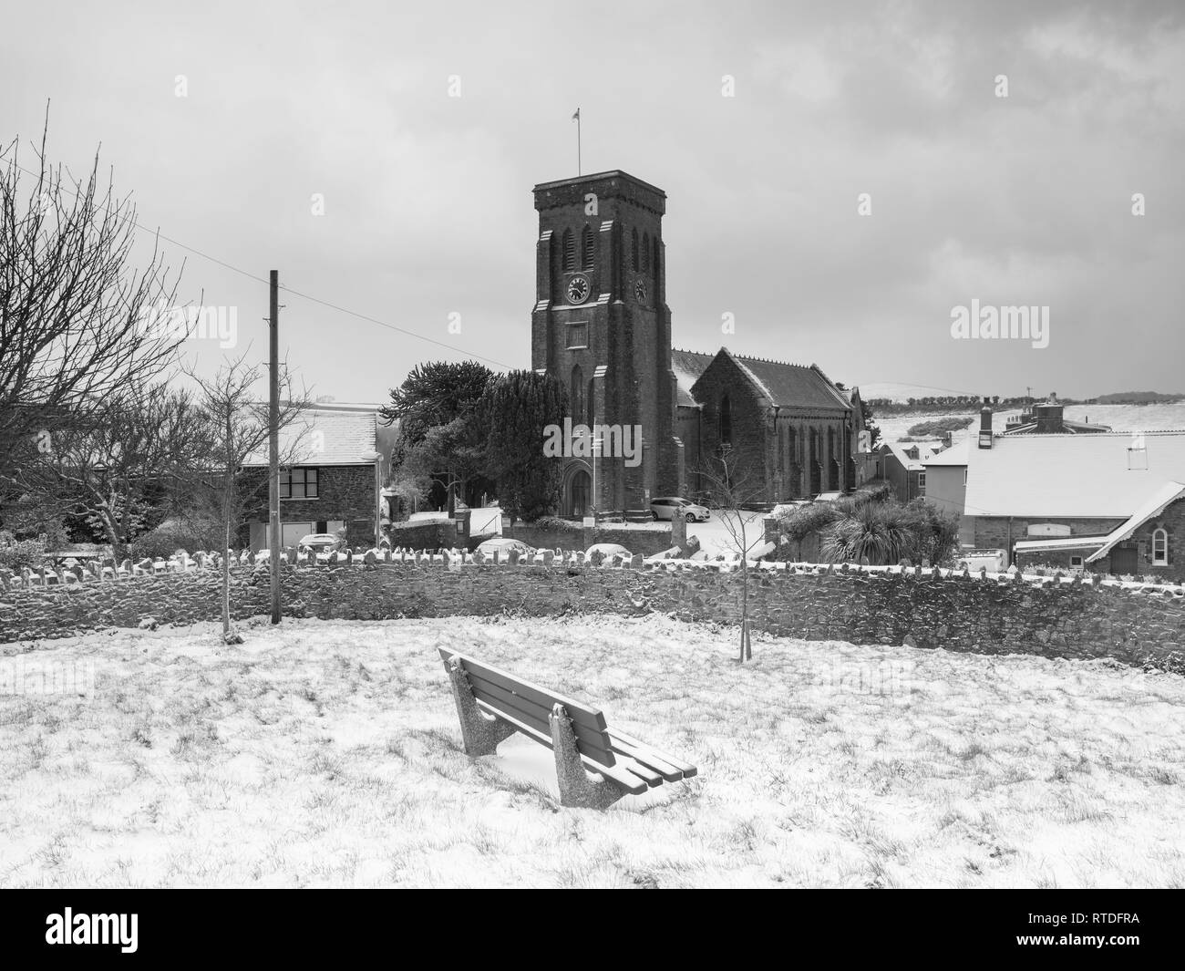 A snowy scene of Salcombe's Trinity Church after the beast from the east struck south devon. Salcombe was then hit by Storm Emma. - Stock Image