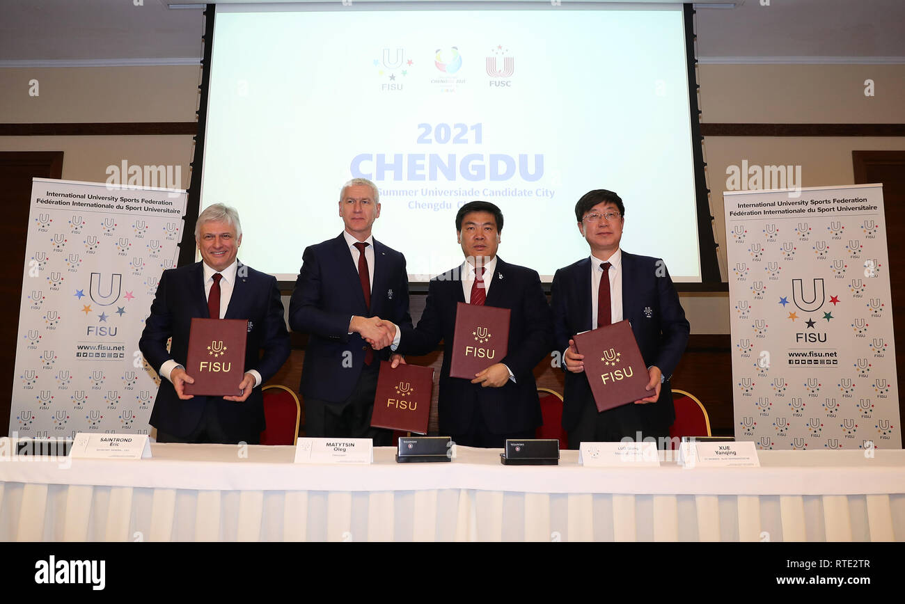 Krasnoyarsk, Russia. 1st Mar, 2019. FISU Director-General and CEO Eric Saintrond, FISU President Oleg Matytsin, Mayor of Chengdu Luo Qiang and Chairman of Asian Universities Sports Federation and Vice President of Federation of University Sports of China Xue Yanqing (From L to R) pose after a signing ceremony at the FISU Executive Committee meeting in Krasnoyarsk, Russia, March 1, 2019. The International University Sports Federation (FISU) announced on Friday that the Chinese city of Chengdu will host the 2021 Summer Universiade. Credit: Wang Dongzhen/Xinhua/Alamy Live News - Stock Image