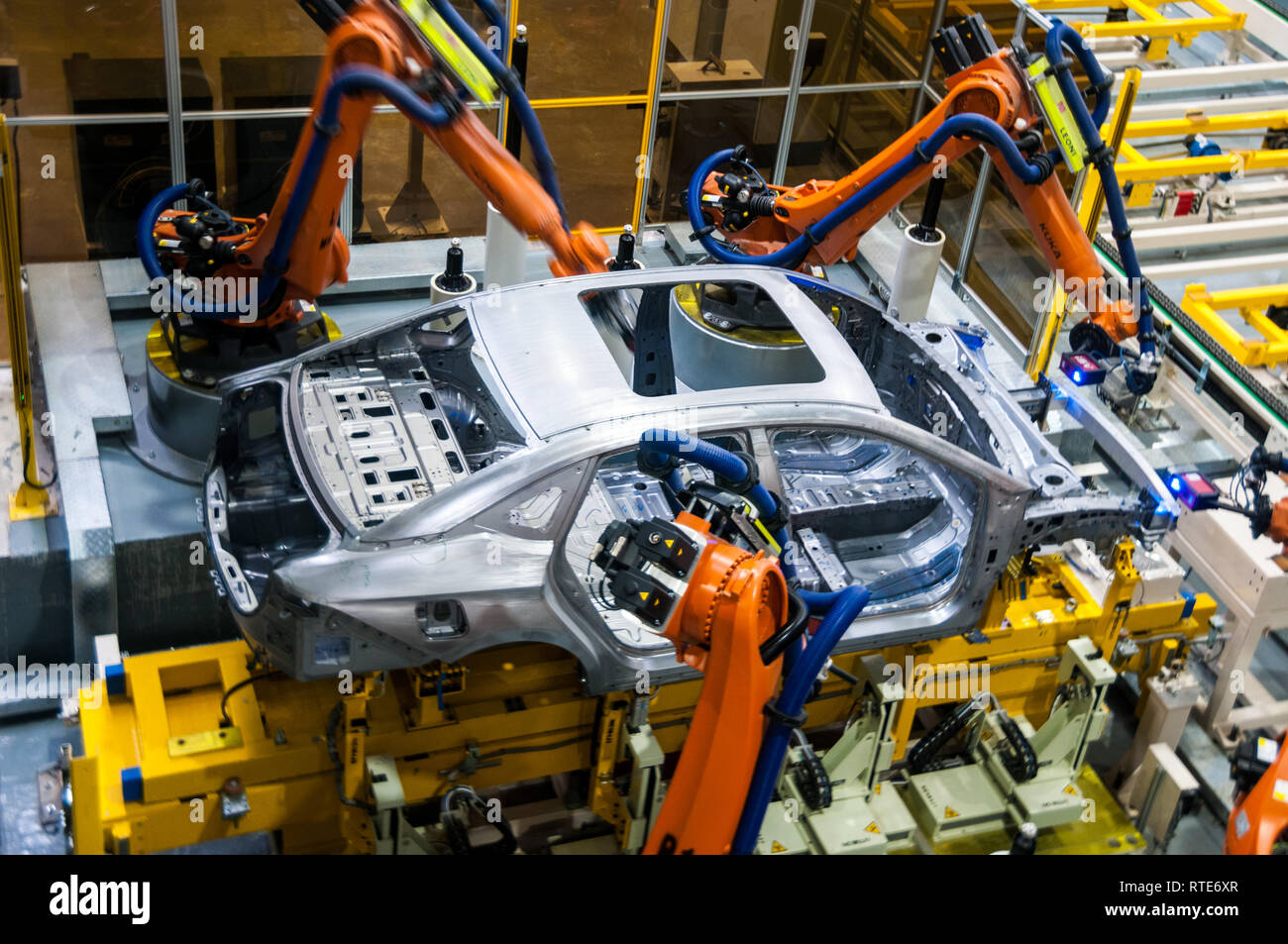 Guangzhou, China. 1st March, 2019. Robots working and measuring on the production line at the Guangzhou factory. Official launch of the GAC NE Aion S electric car billed as the Chinese Tesla Model 3 killer at the GAC NE factory in Guangzhou, Guangdong Province, China. Mark Andrews/Alamy Live News - Stock Image