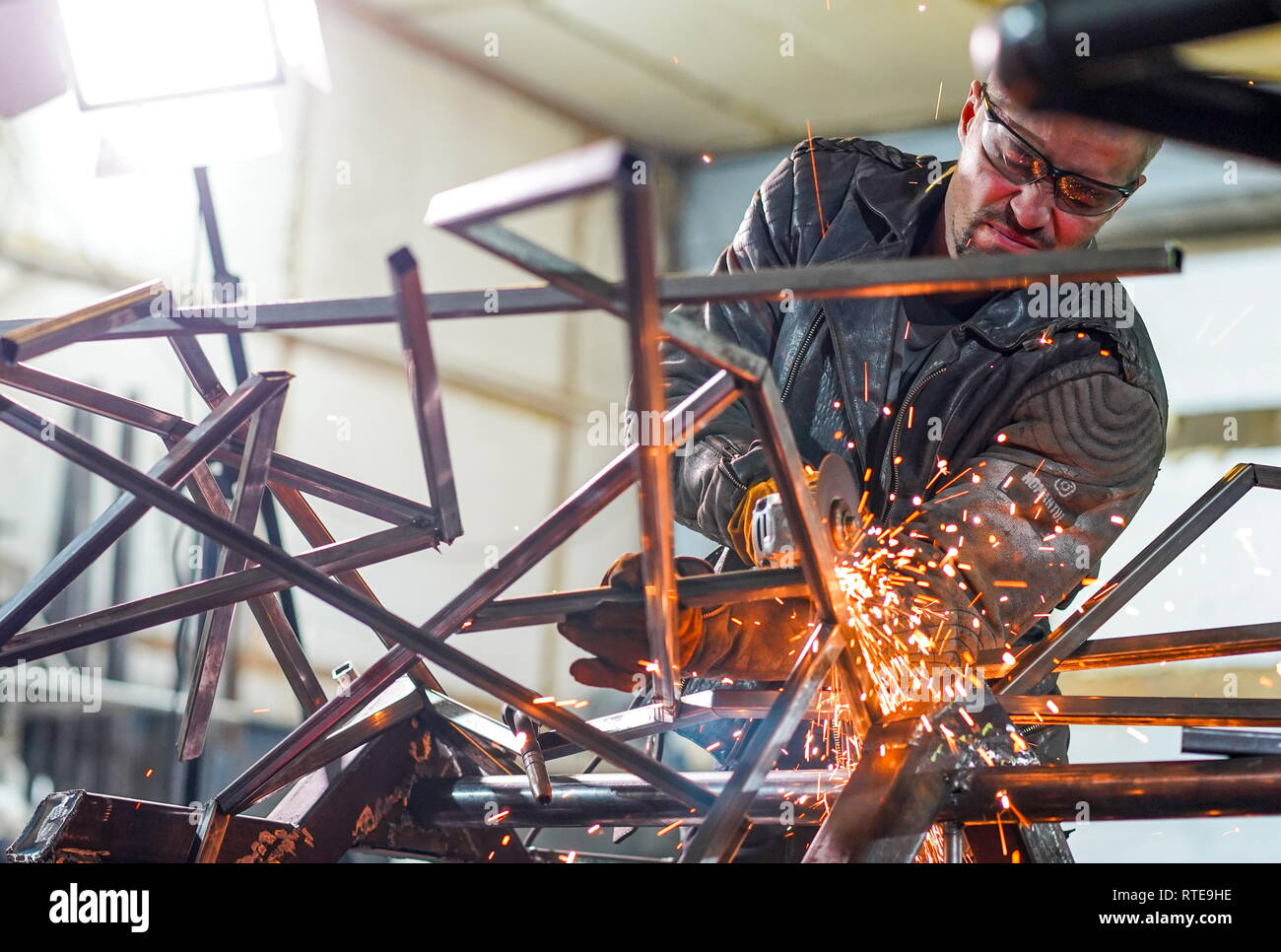 Irkutsk, Russia. 21st Feb, 2019. IRKUTSK, RUSSIA - FEBRUARY 21, 2019: Car mechanic Roman Nikitin is tuning a car in his workshop; Roman Nikitin custom tunes cars and motorcycles in the post apocalyptic style. Alyona Shatuyeva/TASS Credit: ITAR-TASS News Agency/Alamy Live News - Stock Image
