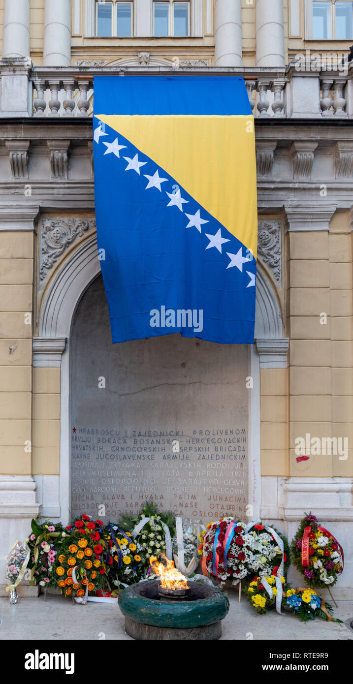 Sarajevo, Bosnia And Herzegovina. 1st March, 2019. . Bosnian flag and wreaths around Eternal flame for Independence Day Credit: Vedad Ceric/Alamy Live News - Stock Image
