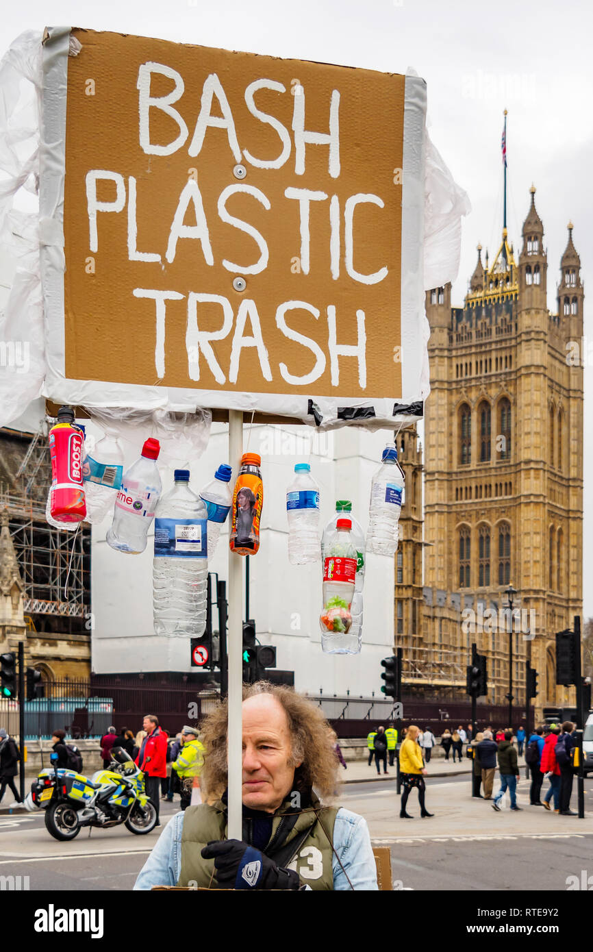 London, UK. 1st March 2019. A giant plastic bottle made up of plastic bottles outside the Department for Environment, Food & Rural Affairs (DEFRA) and a lone protesters outside Parliament both called for an end to the enormous volume of plastic waste, much dumped to pollute the sea or buried in landfill. Campaigners want all plastic containers to be recyclable and for a deposit to be levied on all drink bottles to encourage re-cycling. Credit: Peter Marshall/Alamy Live News - Stock Image