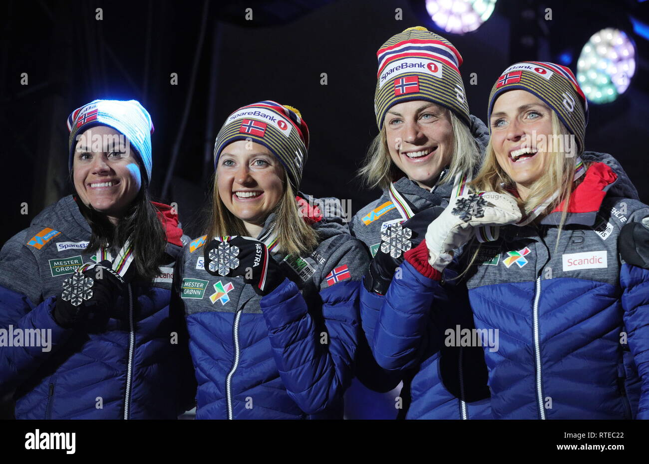 Seefeld, Austria. 28th Feb, 2019. TYROL, AUSTRIA - FEBRUARY 28, 2019: Silver medallists Heidi Weng, Ingvild Flugstad Oestberg, Astrid Uhrenholdt Jacobsen, and Therese Johaug of Norway (L-R) show their medals during the medal ceremony for women's 4 x 5 km relay classic/free at the 2019 FIS Nordic World Ski Championships in Seefeld. Sergei Bobylev/TASS Credit: ITAR-TASS News Agency/Alamy Live News - Stock Image