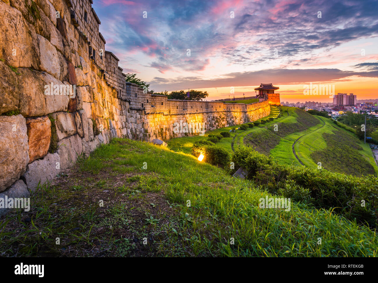 Hwaseong Fortress in Sunset, Traditional Architecture of Korea at Suwon, South Korea. Stock Photo