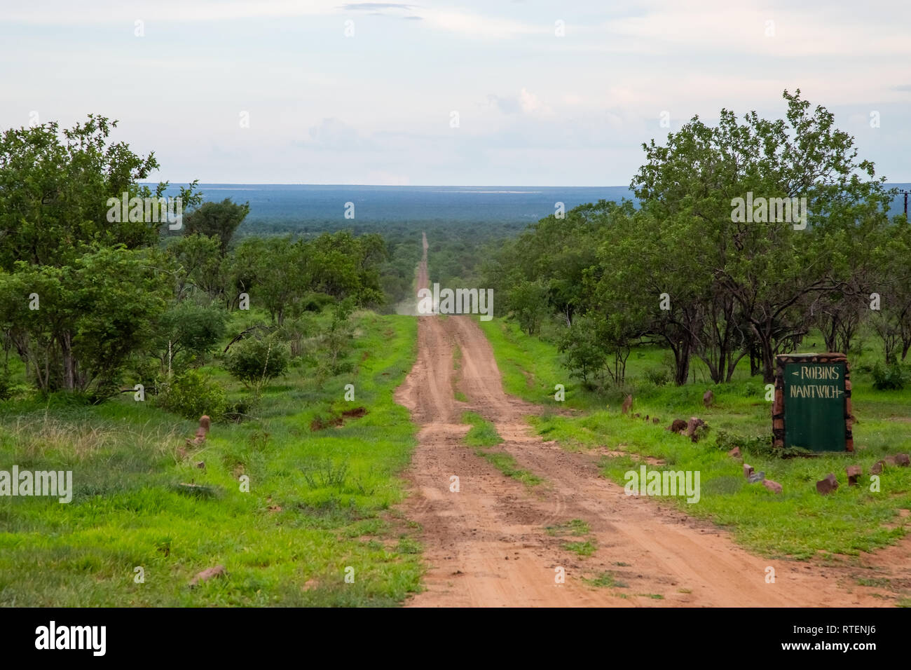 Hwange, Zimbabwe, 7 January - 2019: Entrance road into Hwange National Park. Stock Photo