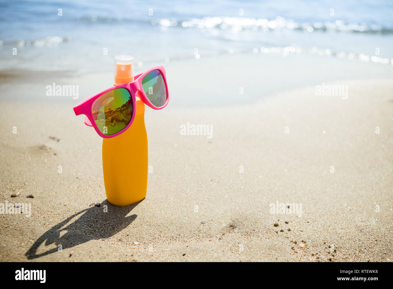 0ae3ae5d861 Various sunsreen products in the sand. cosmetic bottles for personal care  isolated on beach background