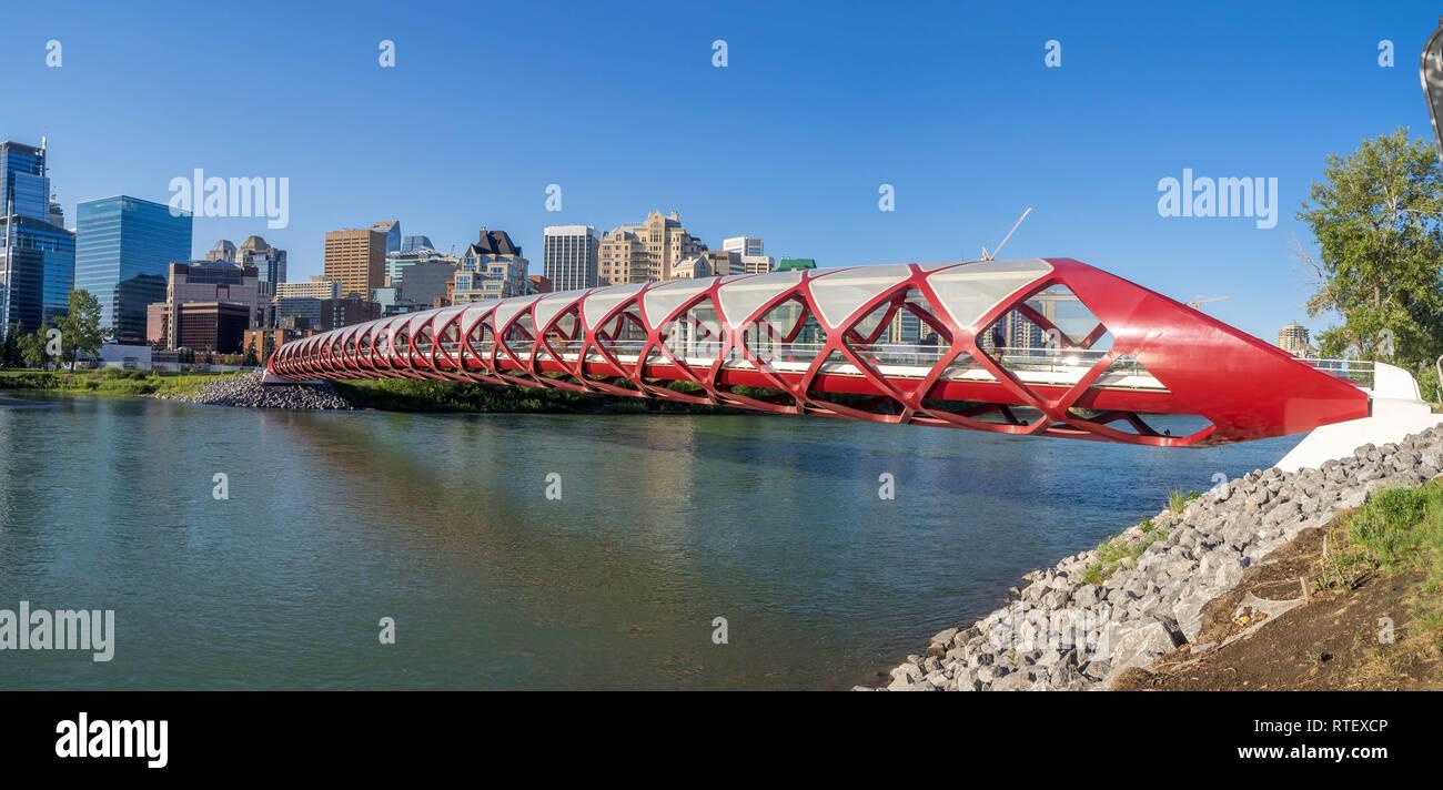 The Peace Bridge spanning the Bow River in Calgary, Alberta. The pedestrian Peace Bridge was designed by celebrity architect Santiago Calatrava. - Stock Image