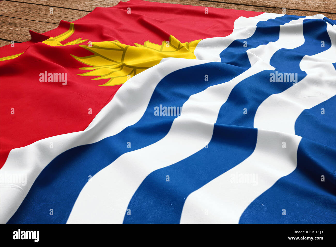 Flag of Kiribati on a wooden desk background. Silk flag top view. - Stock Image