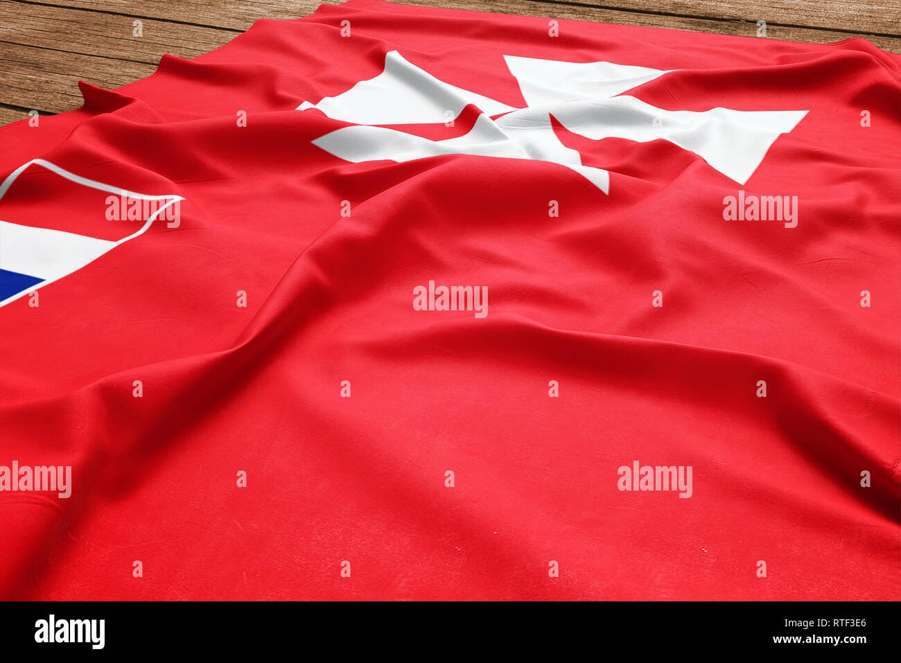 Flag of Wallis And Futuna on a wooden desk background. Silk flag top view. - Stock Image