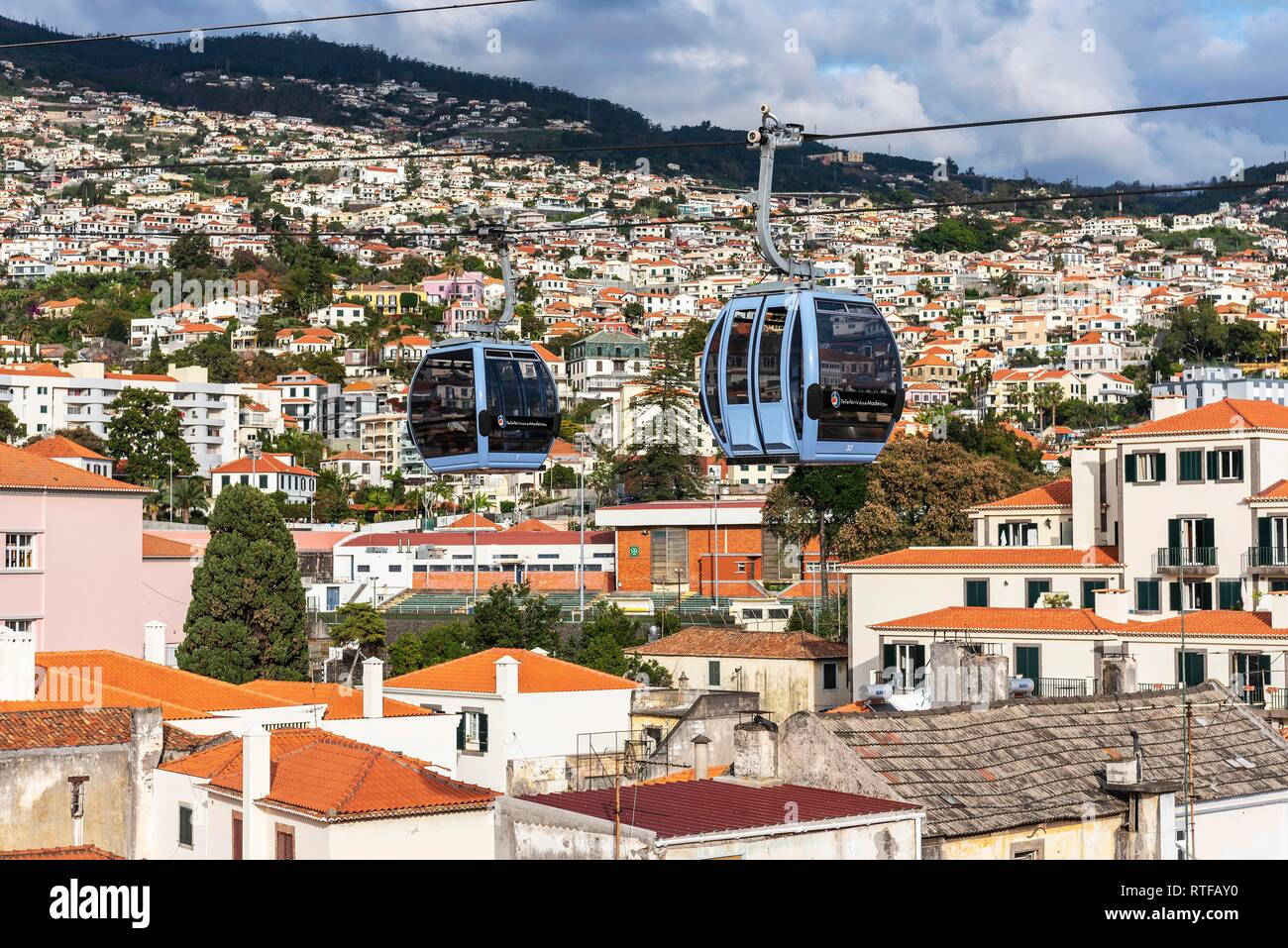 Two cable cars above the roofs of the city, cable car, Teleferico, Funchal, Madeira Island, Portugal - Stock Image