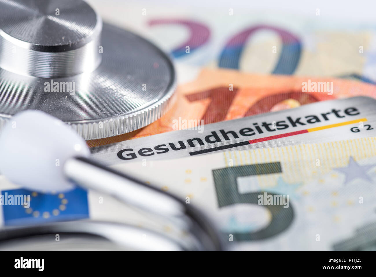 Health card in purse with euro banknotes and stethoscope Stock Photo