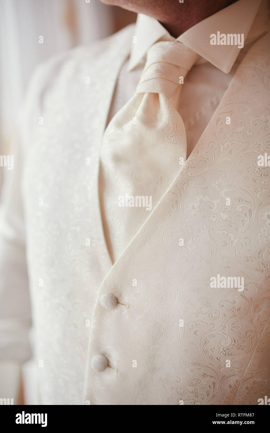 cropped photo close-up men's waistcoat with white pattern. Modern businessman - Stock Image
