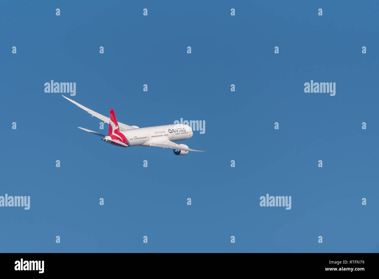 QANTAS Boeing 787 Dreamliner jet airliner plane VH-ZNE taking off from London Heathrow Airport, UK, in blue sky. Flight departure. Space for copy - Stock Image
