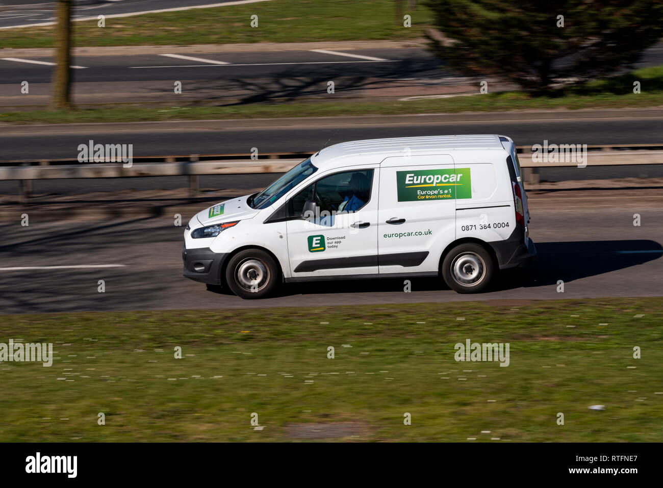 167a0df13c8f36 Europcar white van driving on the road. Car and van rental
