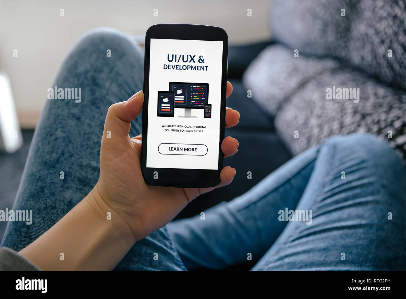 Girl holding smart phone with UI/UX design and development concept on screen. All screen content is designed by me - Stock Image