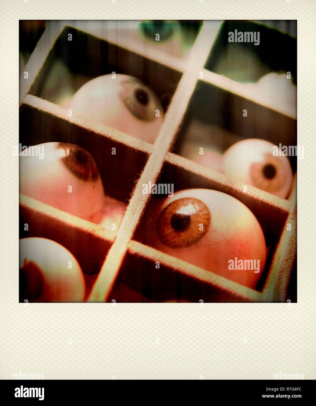 Fake eyes in boxes - Stock Image