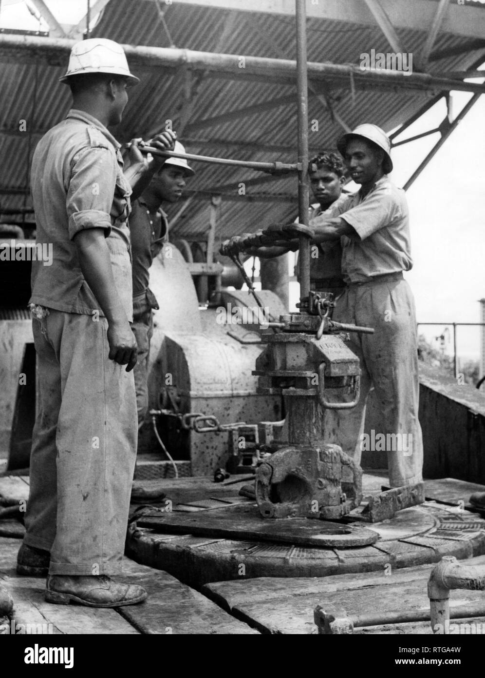 British asia, brunei, Indian workers to oil rigs, 1953 - Stock Image