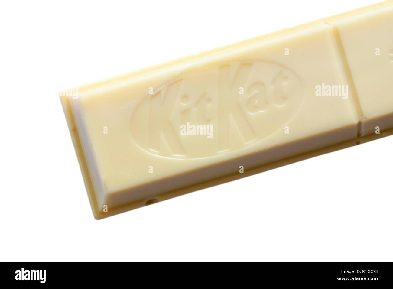 Nestle KitKat chunky white chocolate set on white background - crispy wafer fingers covered with white chocolate - close up - Stock Image